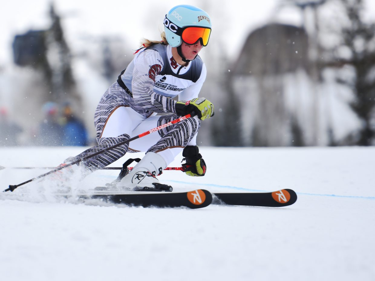 University of Denver senior Kristine Haugen flies down the course Wednesday during the NCAA giant slalom championship at Steamboat Ski Area. She won the race, earning her fourth national championship and her third in the event.