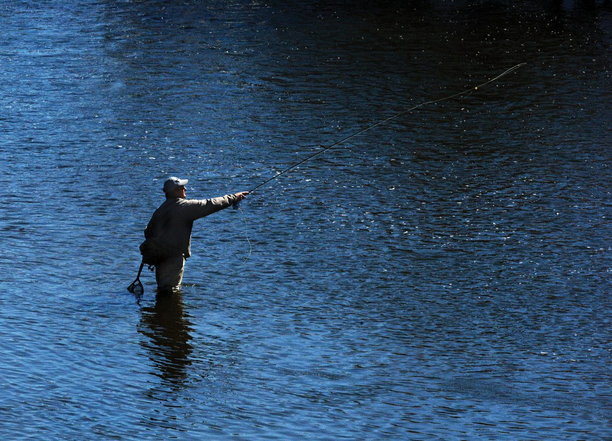 Longtime local Jon Hawes casts his line into the Yampa River Tuesday afternoon. Warm temperatures have fishermen taking advantage of the mild conditions in the Yampa Valley.