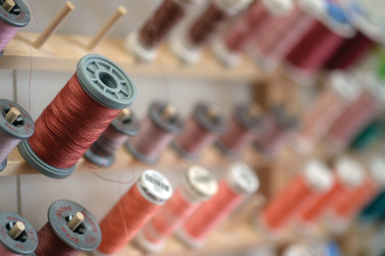 Spools of brightly colored thread line the walls of the Sew What clothing repair business in downtown Steamboat Springs.