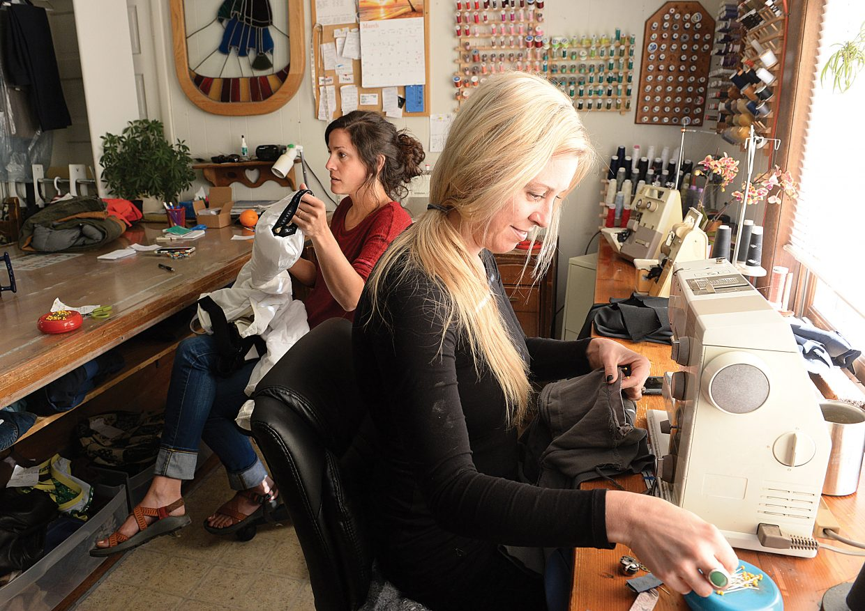 Melissa Dow, front, and Calais Cervetti Kruse will take over operations of Sew What from founder Maggie Bentz. The new alterations store will move a couple of doors down the hall into a new space and add shoes to the list of things that can be repaired.