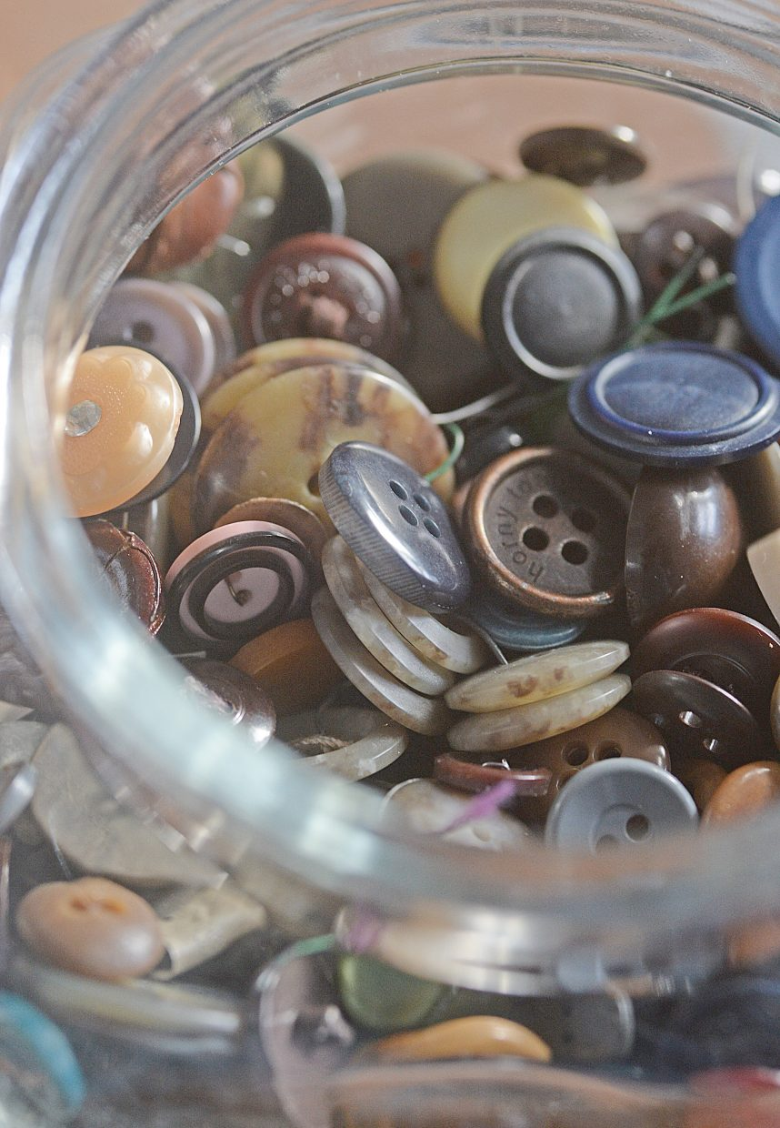 Loose buttons fill a jar at Sew What in downdown Steamboat Springs.