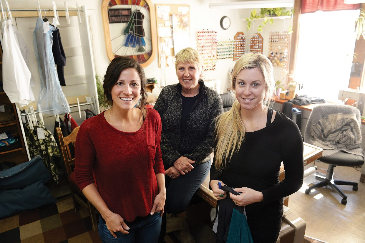 Sew What's new owners Calais Cervetti Kruse, left, and Melissa Dow, right, are joined by business founder Maggie Bentz in the space the business plans to move into later this year. Bentz has sold the business to Cervetti Kruse and Dow after more than 36 years.