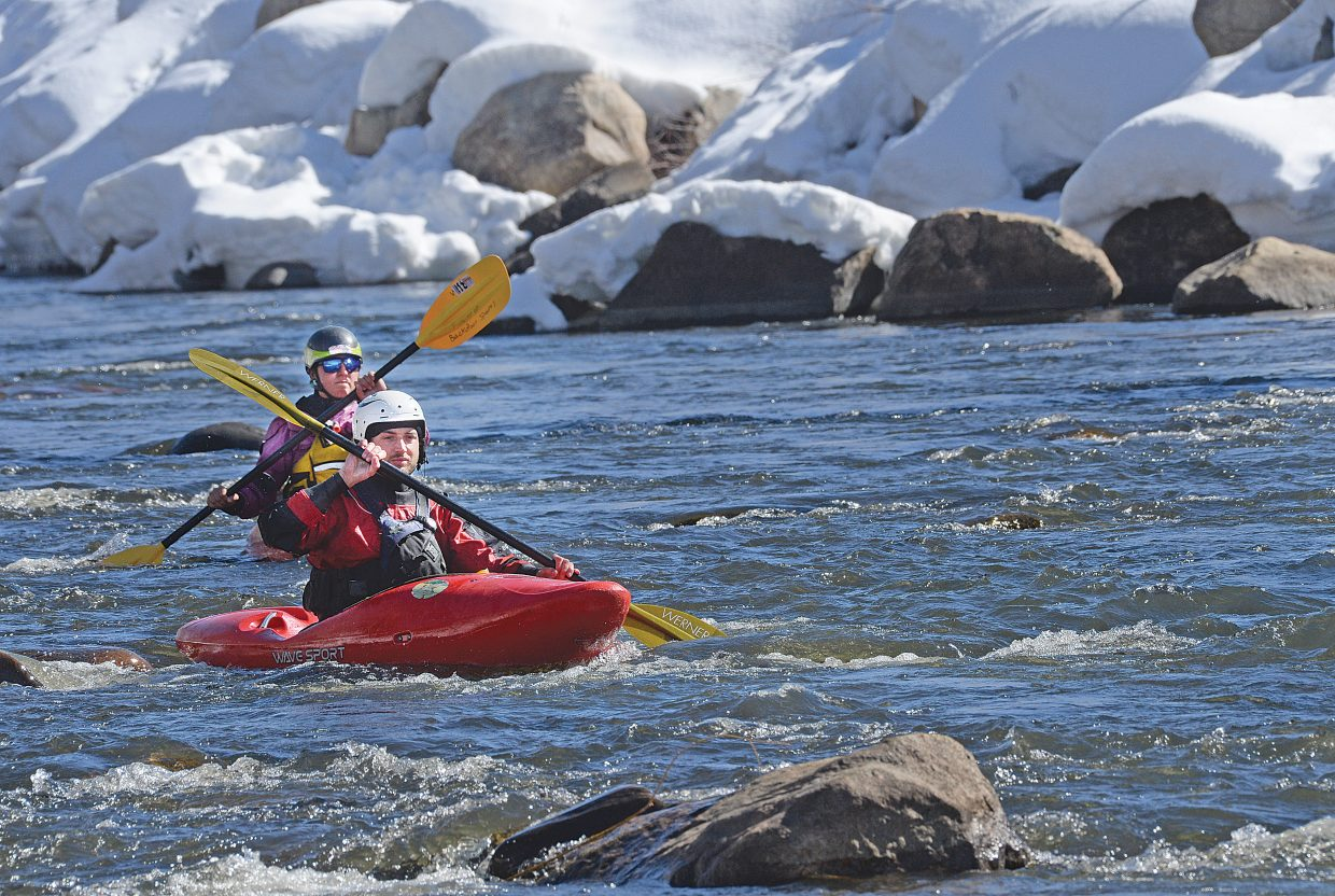 Travis Meek and Nicole Leen take advantage of Thursday's mild weather to make their first decent of the Yampa River this year. There is no question that the warmer temperatures and quickly retreating snow have folks in Steamboat Springs thinking about spring-time activities like kayaking.