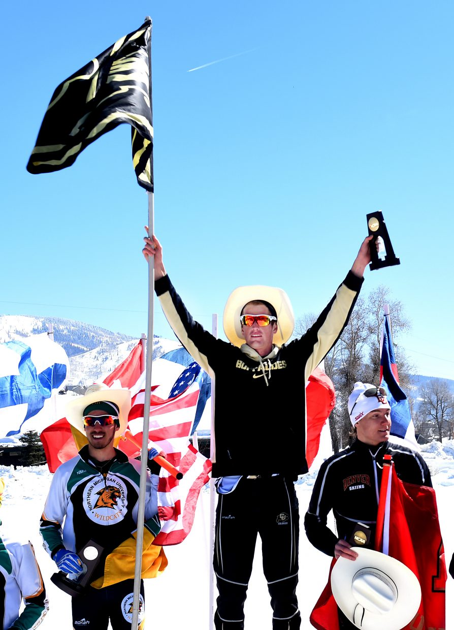 Colorado's Mads Stroem raises his arms in celebration after winning the men's 10K Nordic freestyle skiing race at the NCAA Skiing Championships in Steamboat Springs.