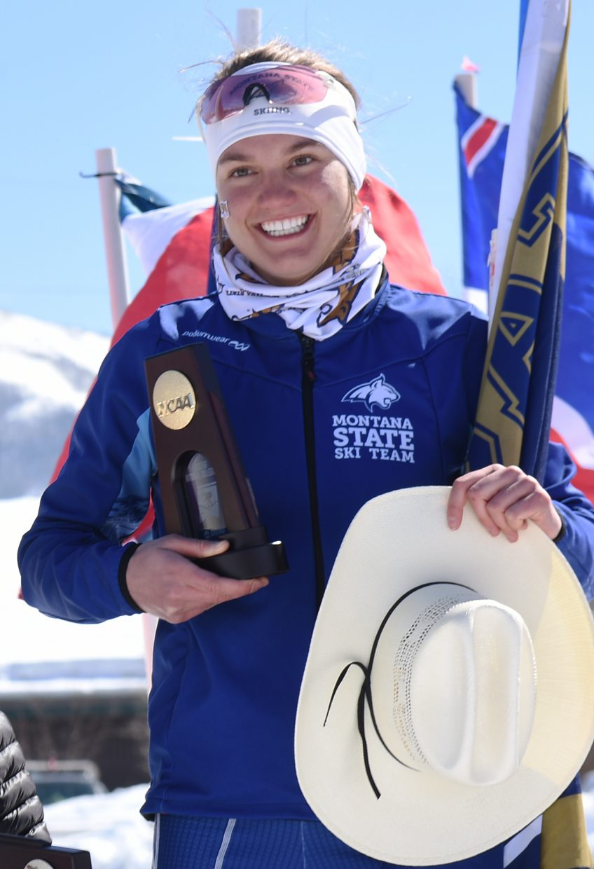 Anika Miller smiles wide after winning the women's 5-kilometer Nordic freestyle skiing event at the NCAA Skiing Championships in Steamboat Springs.