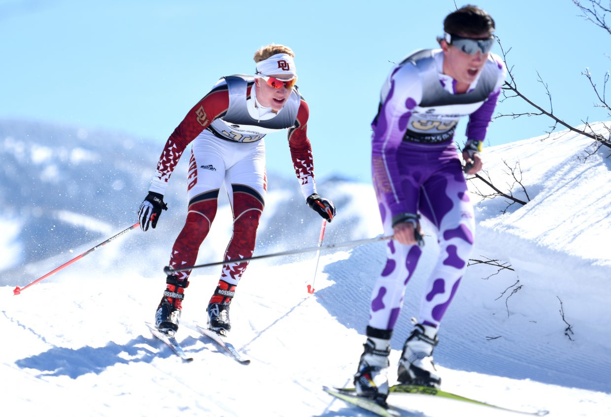 Steamboat Springs skier Lars Hannah, left, hangs behind his opponent before going for a quick pass late in Thursday's NCAA Skiing Championships Nordic race on Emerald Mountain.