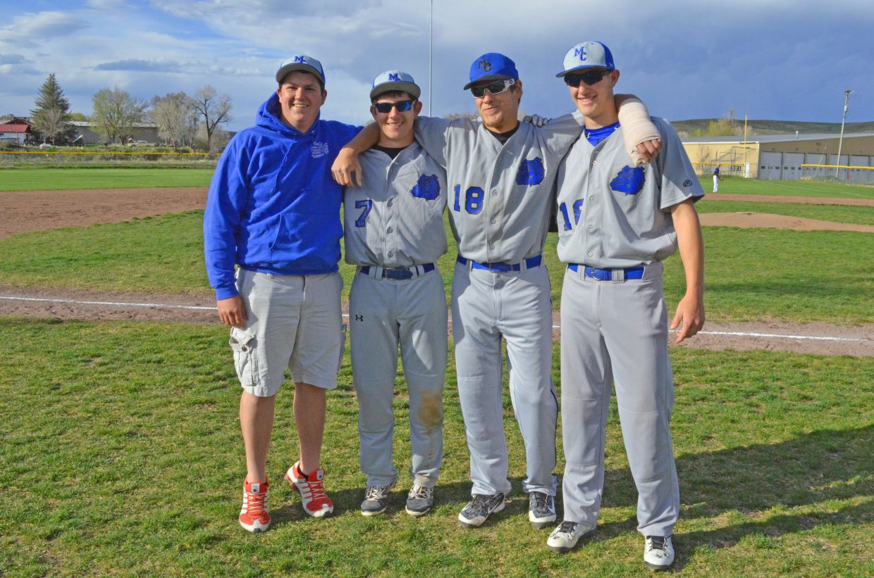 Clayton Moon, far left, gathers with fellow Moffat County High School Class of 2015 graduates Hugh Turner, Phillip Chadwick and Matt Hamilton gather between games of a doubleheader in 2015. Moon, who was killed this week in a car accident and previously served as the Bulldog baseball team manager, will be honored at 4 p.m. Thursday at Craig Middle School with a pregame ceremony.
