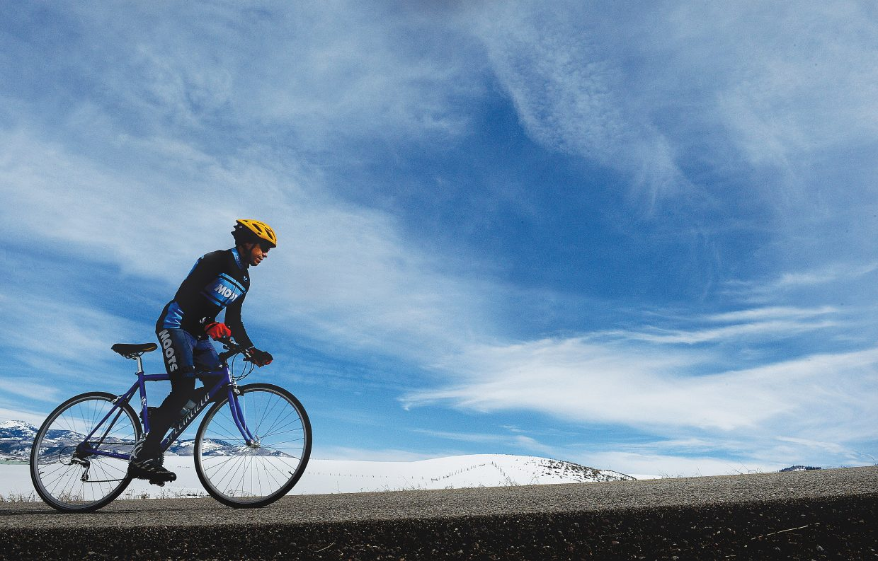 Cyclist Bryce Hagemeier makes his way along Routt County Road 33 just outside of Stemaboat Springs Friday afternoon.