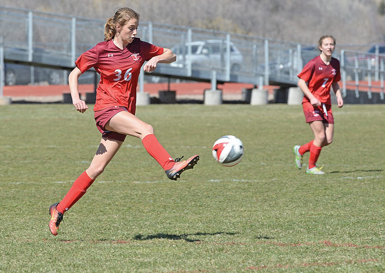 Steamboat Springs freshman Sophie Leeson passes the ball upfield to a teammate in the second half of Saturday's game in Glenwood Springs. Steamboat scored a goal late in the second half, but could not find the equalizer and lost the season-opener, 2-1.