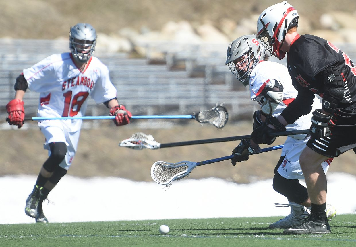 Steamboat's Davis Petersen tries to track down the ball Saturday against Aspen. Petersen scored four goals in the game, but the Skiers scored with seven seconds remaining to break a tie and win the game, 8-7.