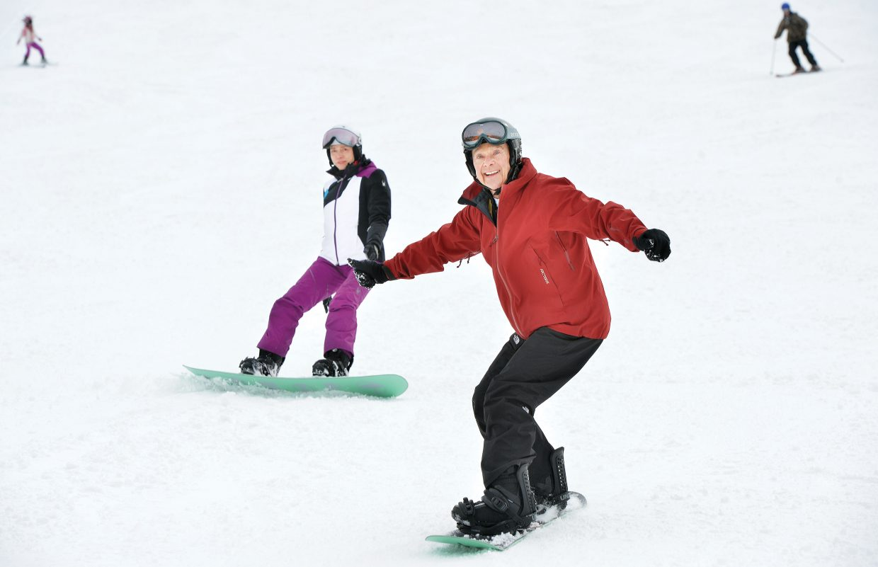 Hal Fischel, 80, rides down the slopes of Steamboat Ski Area Thursday afternoon with his girlfriend, Denise Lovett.