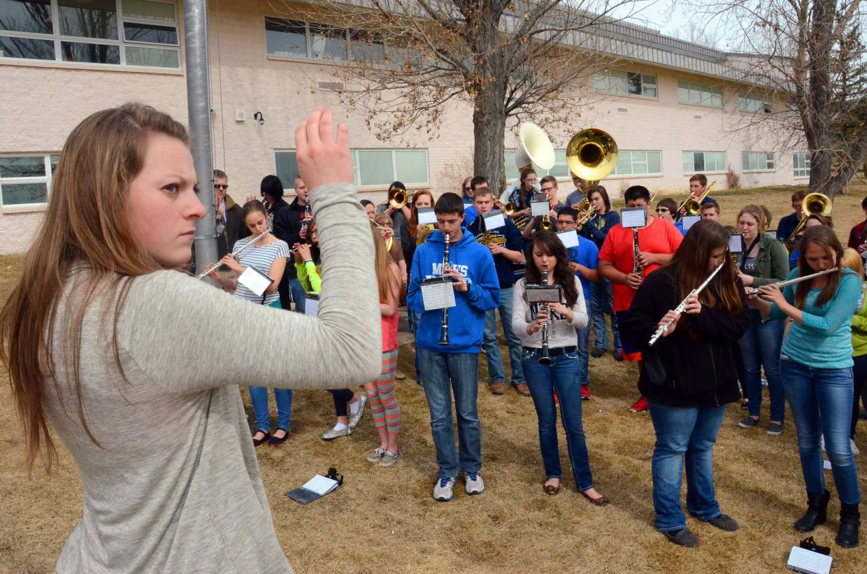 Members of the Moffat County High School band perform on the school's front lawn Wednesday afternoon as the girls basketball team prepares to go to state. The band program and the speech and debate team were also honored as qualifying for state events during a pep assembly.