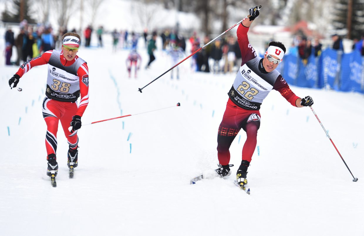 Utah skier Nick Hendrickson, right, who was on the U.S. Nordic Combined Team, reaches his ski across the finish line Saturday during the NCAA Skiing Championships in Steamboat Springs.