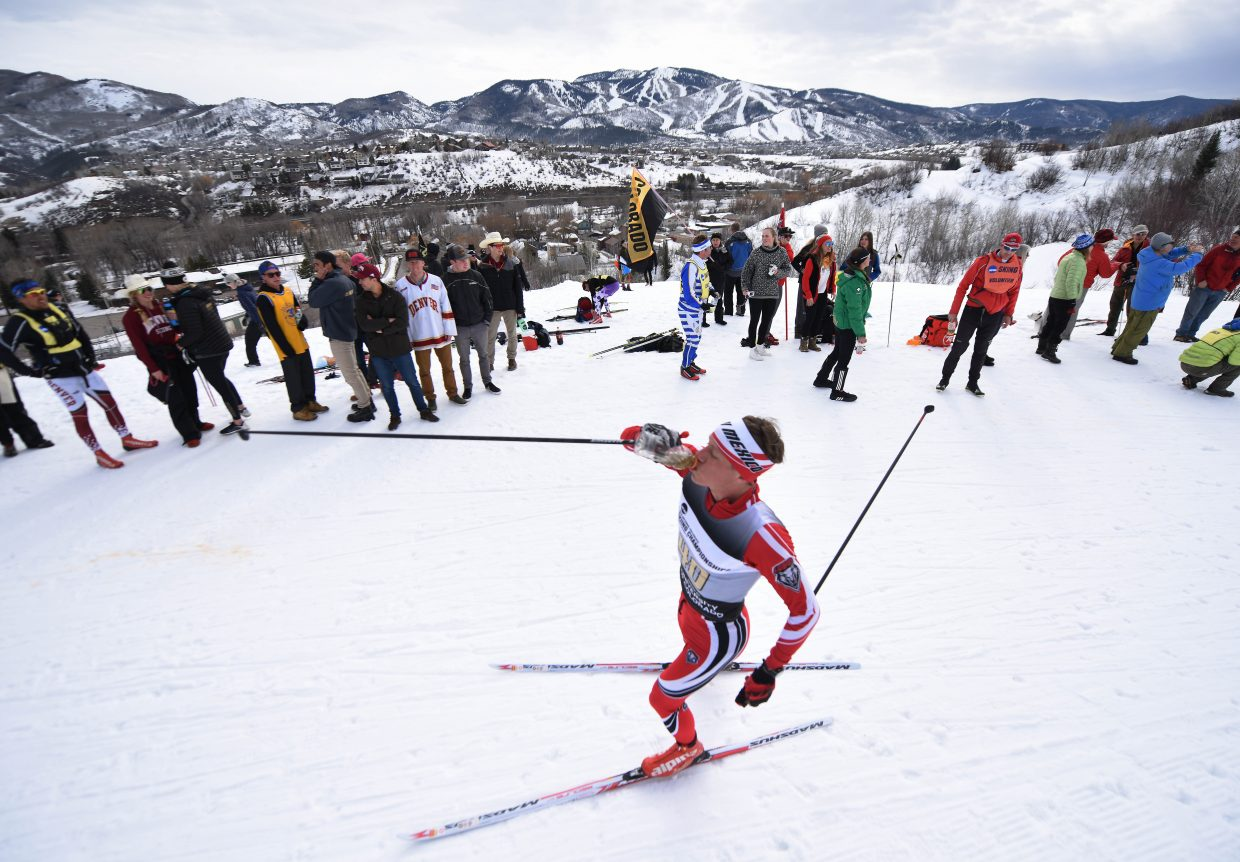New Mexico skier Austin Huneck takes a drink during Saturday's NCAA Skiing Championships Nordic race at Howelsen Hill.