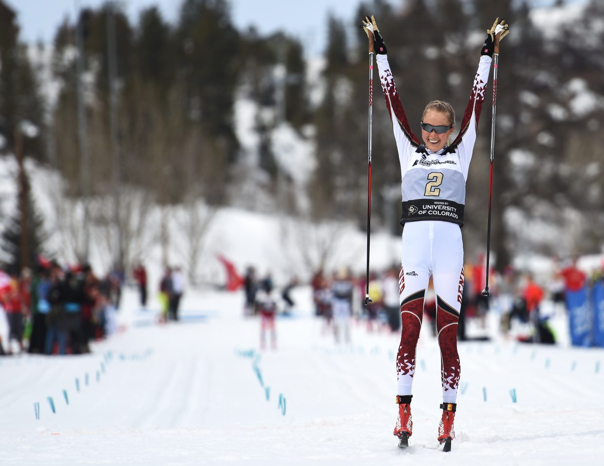 DU's Linn Eriksen throws up her arms after winning the women's 15-kilometer classic skiing Nordic race at the NCAA Skiing Championship Steamboat Springs.