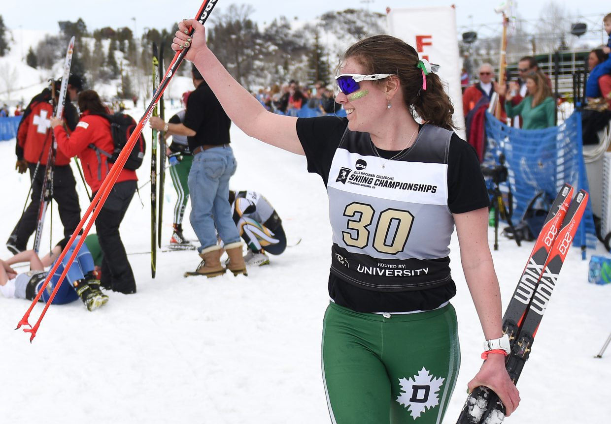 Dartmouth senior Mary O'Connell, who grew up in Steamboat Springs, waves to the crowd after finishing 11th in the women's 15K Nordic classic skiing race at Howelsen Hill at the NCAA Skiing Championships.
