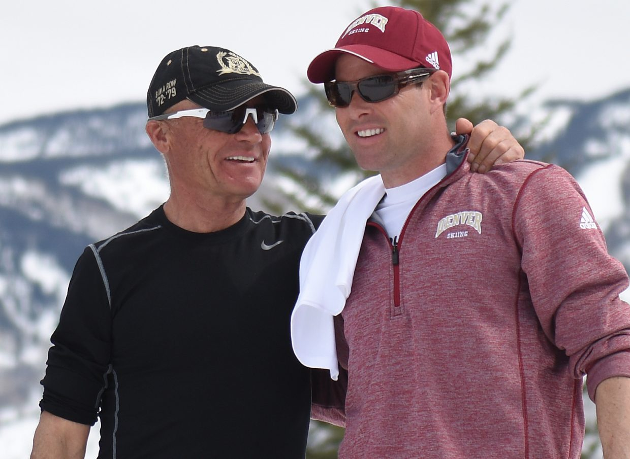 Colorado skiing coach Richard Rokos and University of Denver coach Andy Leroy share a moment during the NCAA Skiing Championships award ceremony Saturday afternoon. Leroy's Pioneers won the event while the Buffs finished second.