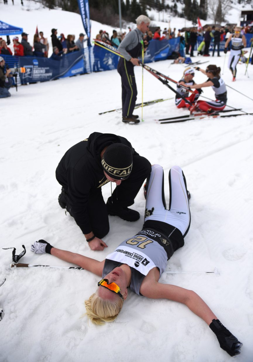 Colorado's Ane Johnsen recovers at the finish line after finishing third in the women's 15K classic skiing Nordic event at the NCAA Skiing Championships in Steamboat Springs.