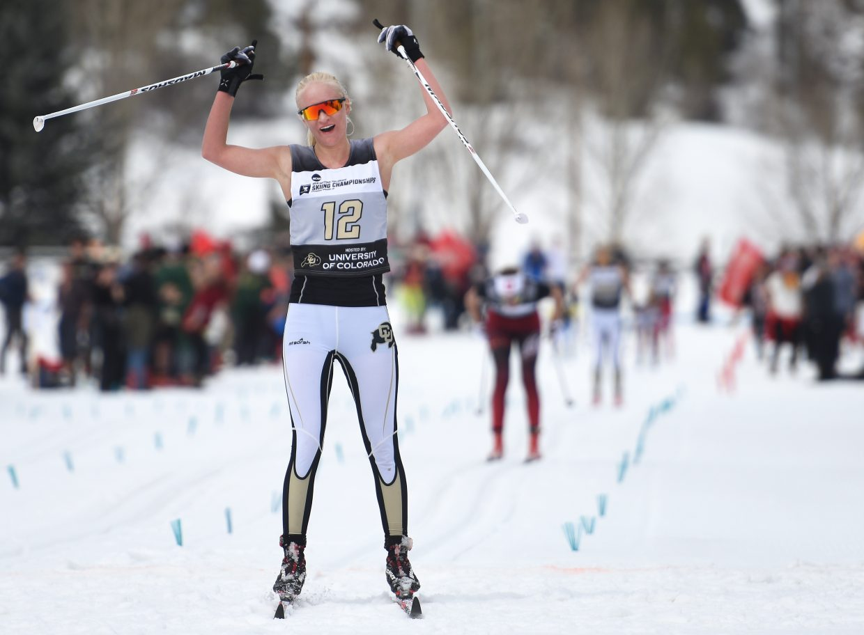 Colorado's Ane Johnsen throws up her arms at the finish line after finishing third in the women's 15K classic skiing Nordic event at the NCAA Skiing Championships in Steamboat Springs.