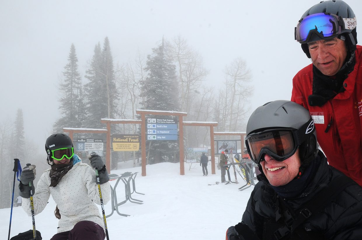 Jim Cartwright, center, shares a laugh with Steamboat Adaptive Recreational Sports Operations Director Ron Southworth, right, prior to skiing Monday at the Steamboat Ski Area.