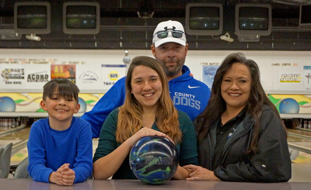 John and Shirely Cromer, along with their son, Jaden, show how proud they are of Sheyenne's bowling success.