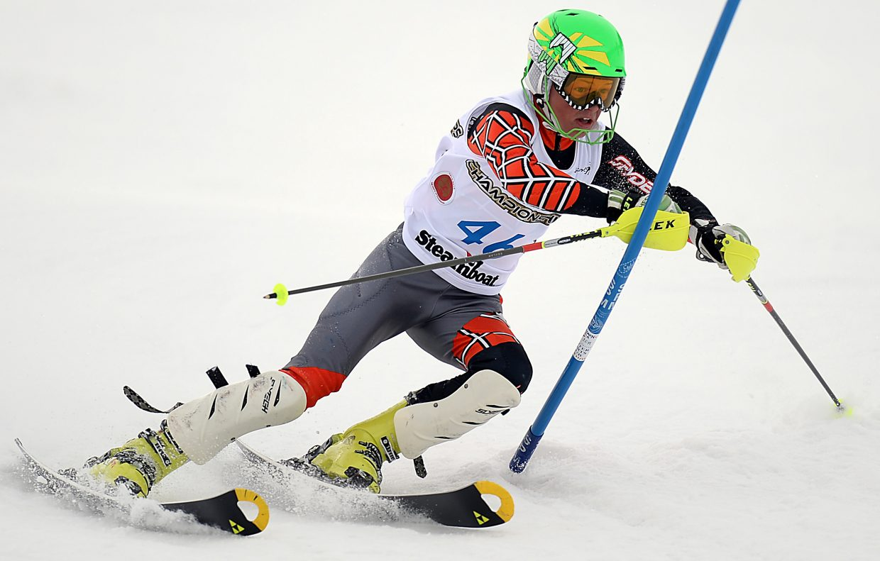 Jett Seymour bends his skis hard as he cuts around a gate Saturday in a slalom race at Howelsen Hill.