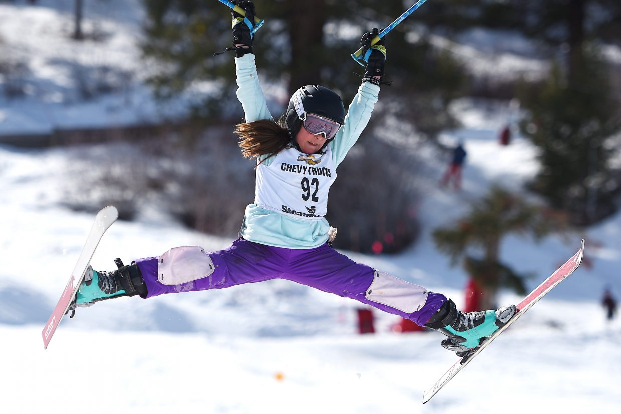 Team Summit skier Lilly Koren splits her skis wide coming off a jump Saturday at a freestyle skiing event in Steamboat Springs.