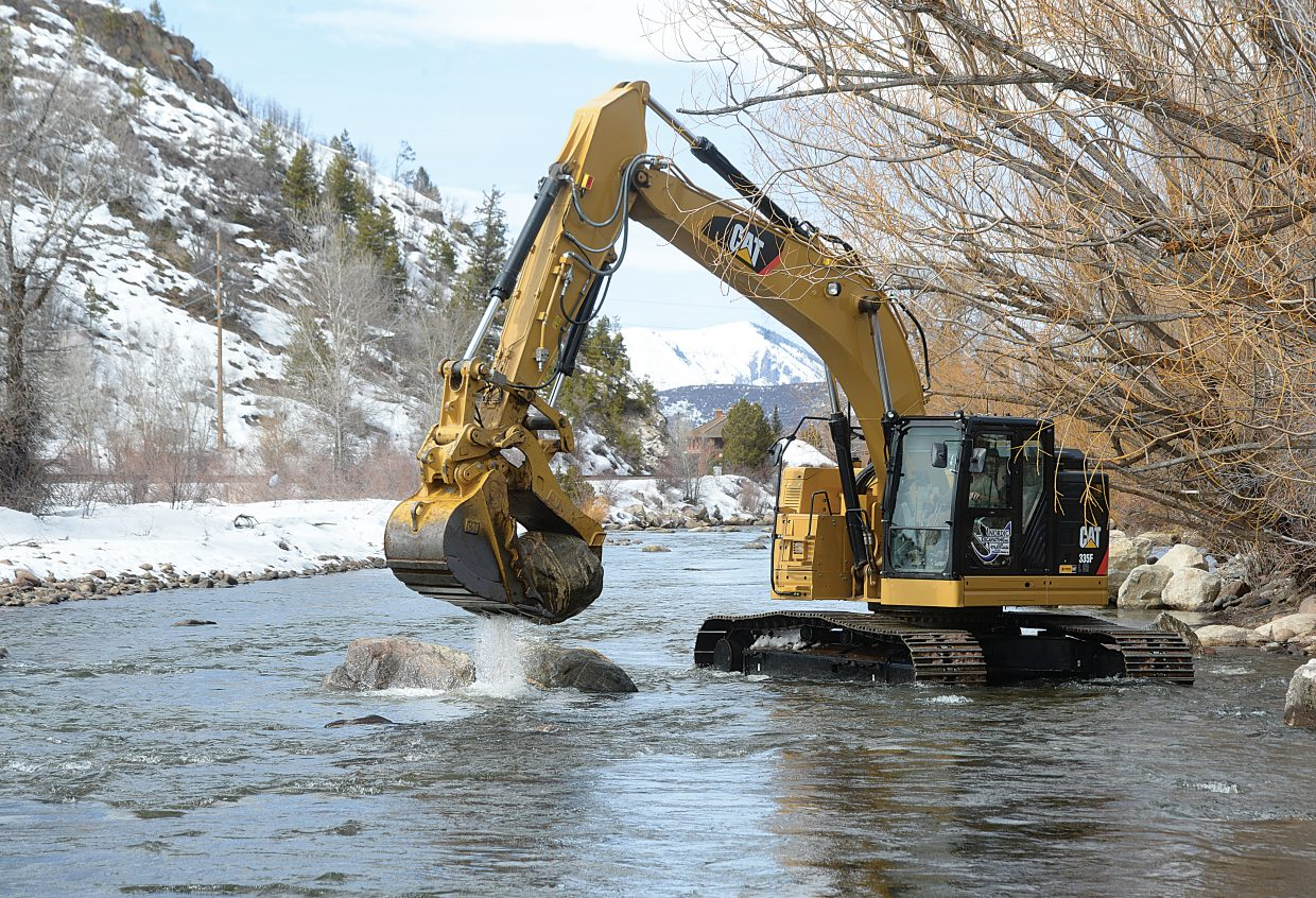 A heavy equipment operator from Nordic Excavating moves large rocks in the Yampa River as part of aN improvement project. The City of Steamboat Springs Parks and Community Services Department is conducting river improvement work on the river along Yampa Street, from Little Toots Park to the Ambulance Barn. The work is estimated to take approximately two weeks.