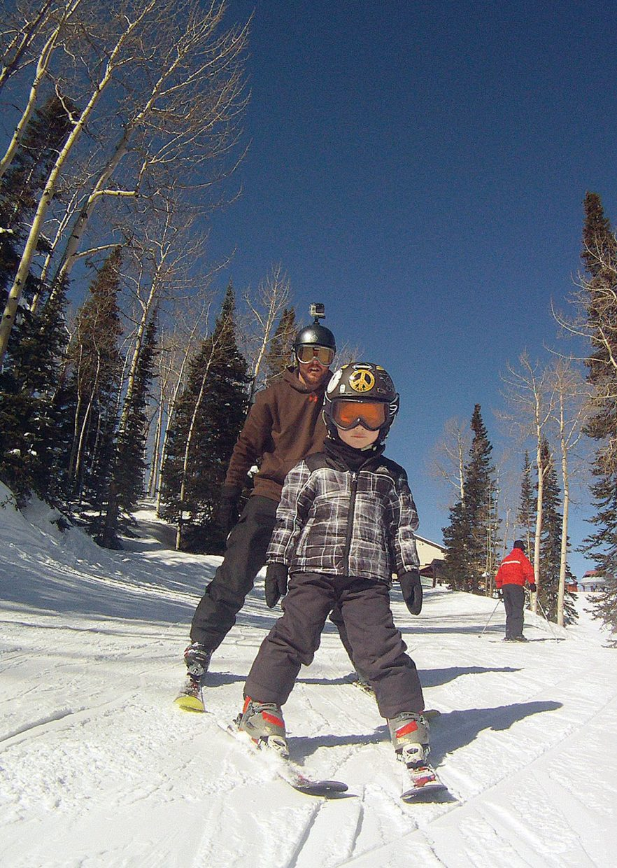 Michael Shoults uses a GoPro to record his son Bryce skiing during a visit to Steamboat Springs last week.