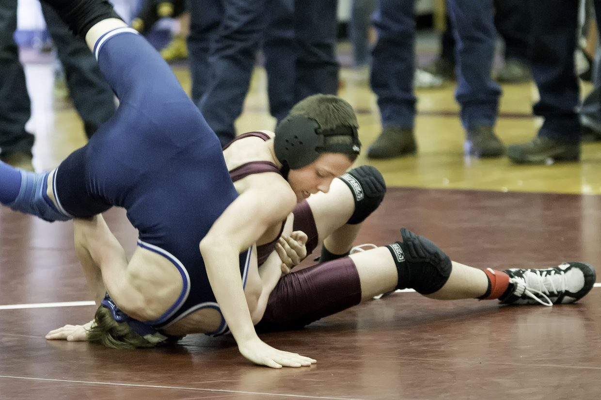 Soroco's Jace Logan wrestles Blake Nelson of Moffat County Middle School in the championship match of the 110-pound bracket Saturday at a wrestling tournament in Oak Creek. Logan won the match, 17-0.