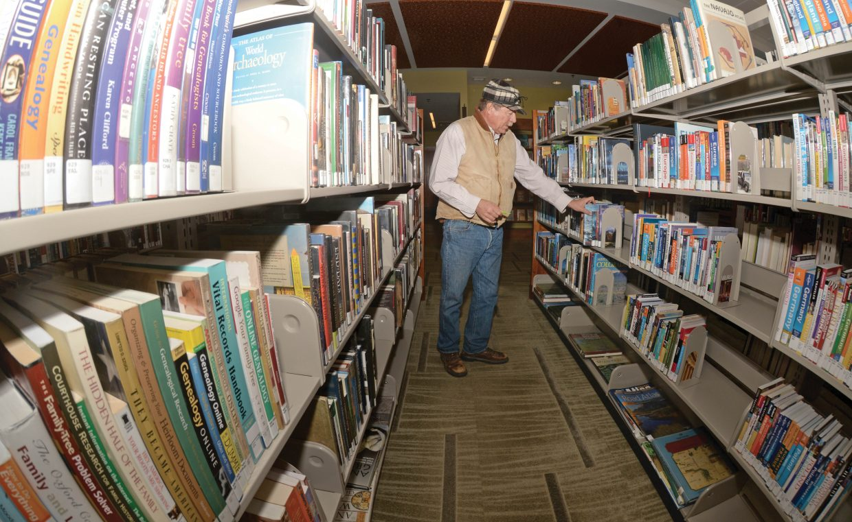 John Fisher searches for a book at the Bud Werner Memorial Library in downtown Steamboat Springs. The library was a great place to escape the blustery winds and cold temperatures outside Tuesday afternoon.