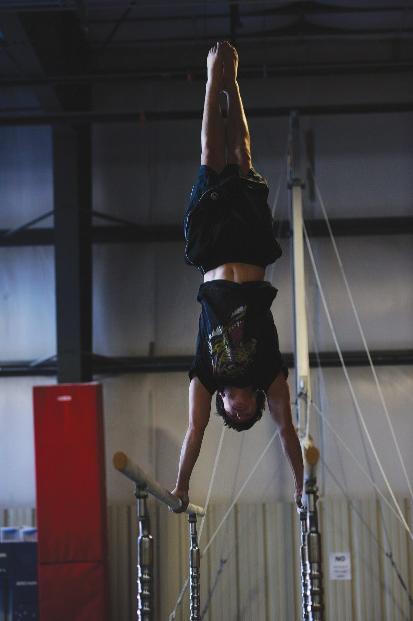Excel gymnast Cole Gibbs works out on the uneven bars during a practice session Monday afternoon. Gibbs and several of his teammates will be headed to the state meet this weekend in Wheat Ridge.