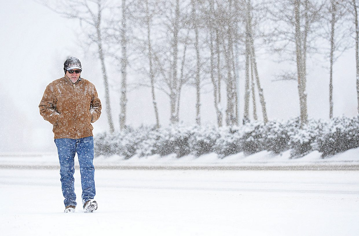 Longtime Steamboat Springs resident Jay Muhme is used to the often-changing weather in Routt County in the spring, and he wasn't about to let it stop him from taking a walk Wednesday morning. The heavy snow was a reminder there are still a few more days of winter left on the calendar.