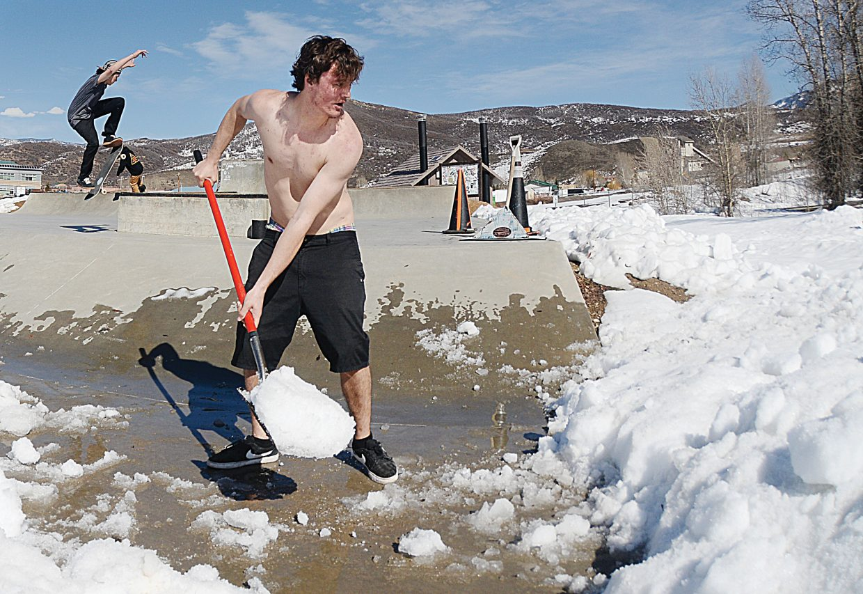 Tyler Lee shovels snow off the concrete at the Bear River Skate Park Thursday afternoon. Recent warm temperatures have allowed skaters to begin using the park's features, but Thursday, Lee and a few buddies brought shovels, hoping to use a little elbow grease and give Mother Nature a helping hand.