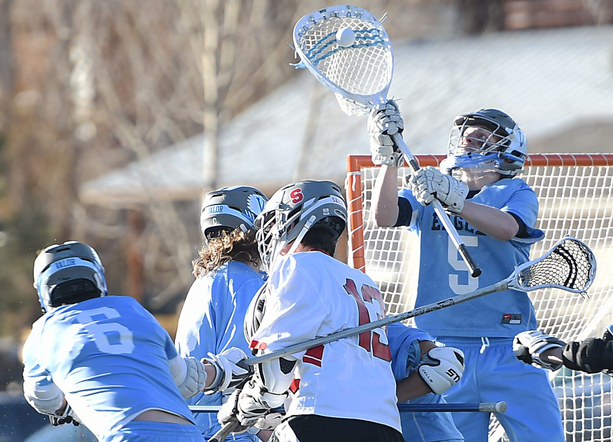 Valor Christian goalie Shawn Johnson scoops a Steamboat Springs shot out of the air Tuesday. Valor scored the last four goals of the game to cement a victory in the latest chapter in its rivalry with Steamboat, 13-8.
