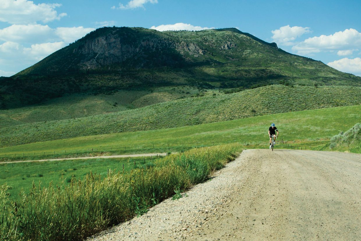 Cyclist Jon Cariveau rides his Moots Psychlo X RSL bike along Routt County Road 46 on the backside of Sleeping Giant. This year's Moots Ranch Rally ride will use this road and many others in the area as part of a 50-mile ride.