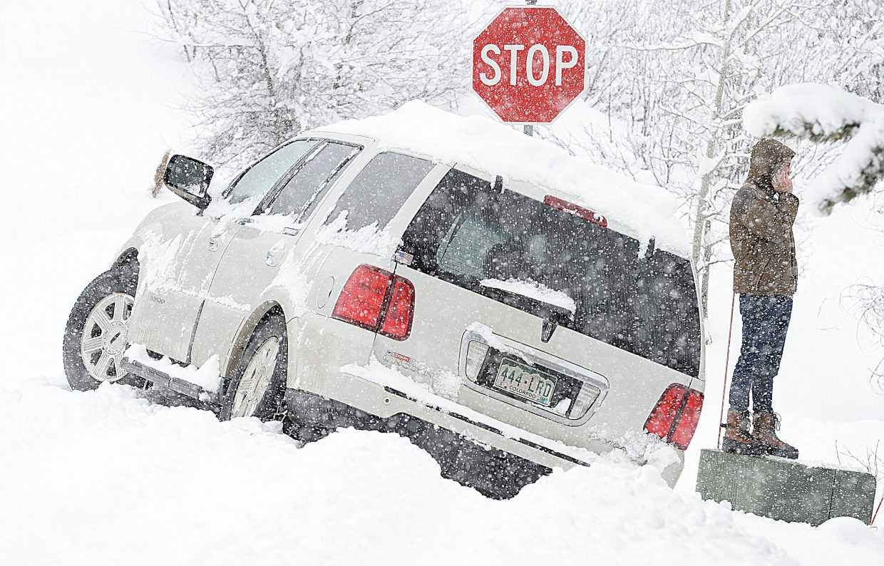 Thursday morning's snow and chilly temperatures made for some tricky driving conditions for local drivers. Nick Smit discovered just how tricky conditions were after his sports utility vehicle slid off the road and ended up in a ditch at the intersection of Amethyst and Fish Creek Falls roads. Luckily, Smit's car was not damaged in the slide off, and he was able to use his cell phone to call a tow truck to get him back on the road.
