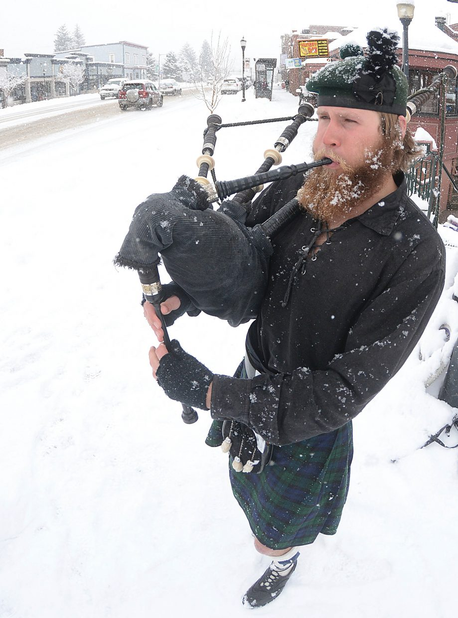Bagpipe player Kevin Moe didn't let a little snow dampen his St. Patrick's Day spirit. Moe pulled on his kilt, braved the frigid weather and played traditional bagpipe tunes for anyone who passed by his location in downtown Steamboat Springs Thursday.
