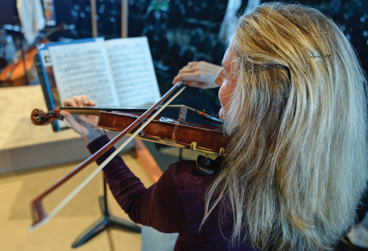 Teresa Steffen Greenlee rehearses a piece of music with the Steamboat Springs Symphony Orchestra in the Strings Music Pavillon.