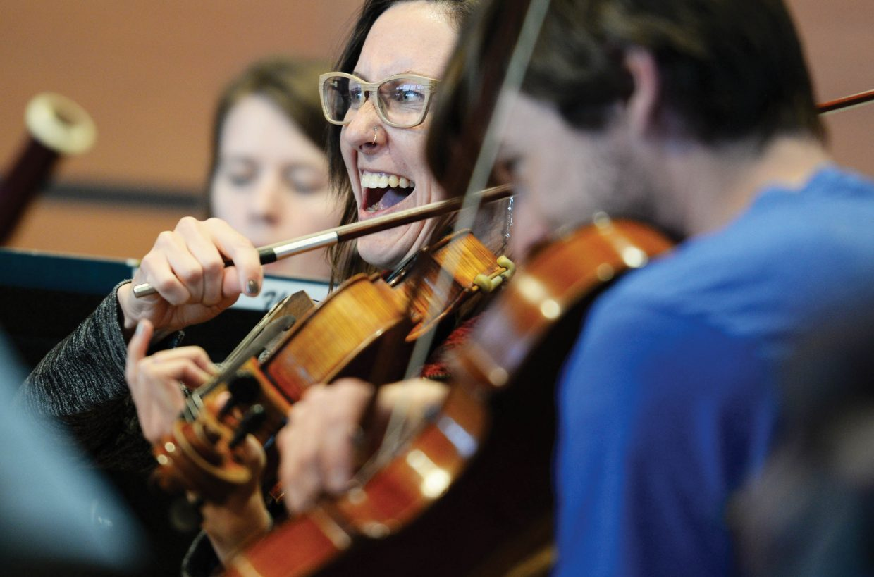 Lauren Spaulding enjoys a moment while rehearsing with the Steamboat Springs Symphony Orchestra Thursday afternoon in Steamboat Springs.