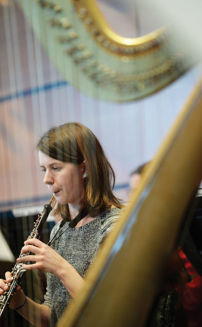 Katie Bloise rehearses with the Steamboat Springs Symphony Orchestra in the Strings Music Pavillon.