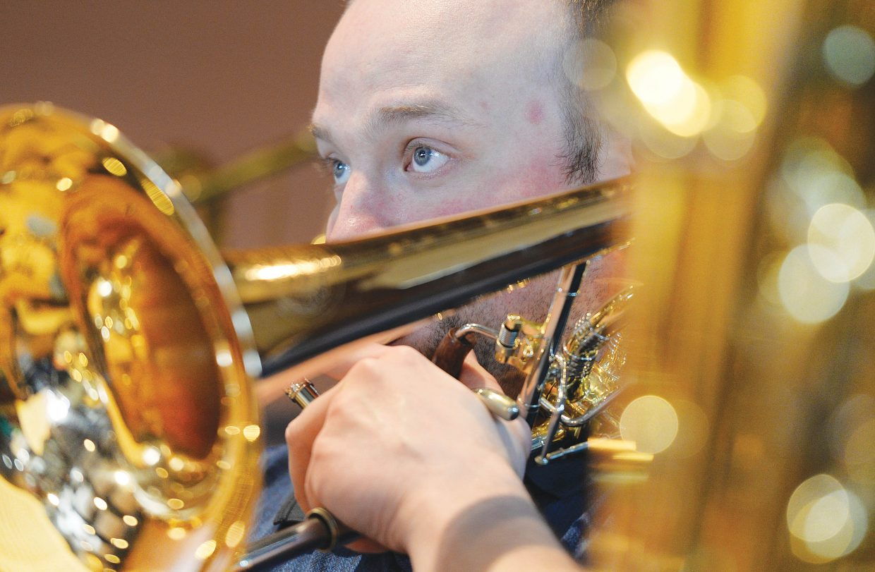 Trombone player Kiel Lauer rehearses with the Steamboat Springs Symphony Orchestra in the Strings Music Pavillon.
