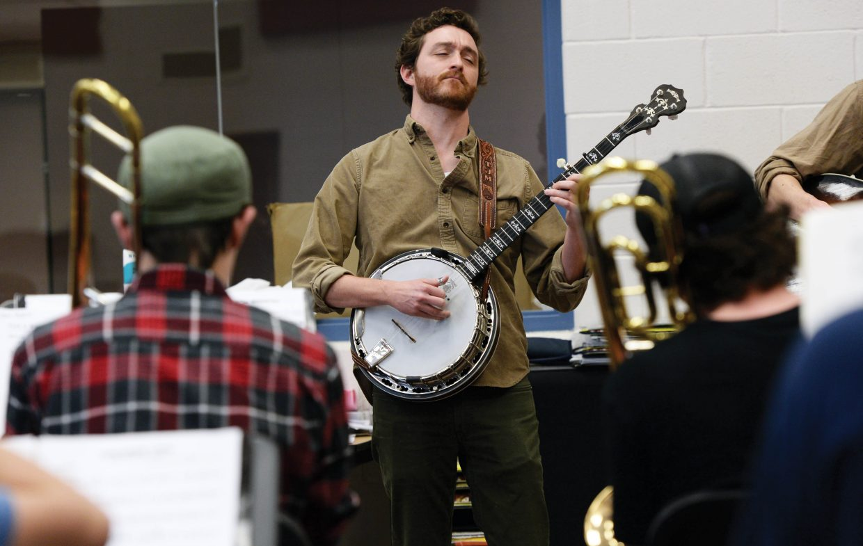 Banjo player Travis McNamara jams with the Steamboat Springs High School's jazz band while preparing for an upcoming concert earlier this week. McNamara and the other members of Trout Steak Revival have been working with area music students as part of the Strings Music Festival's School Days Program.