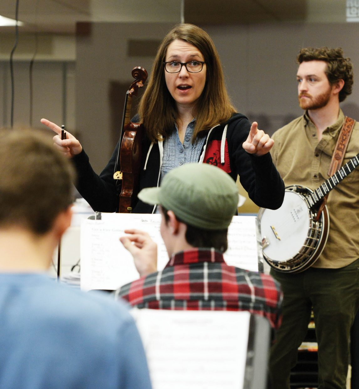 Trout Steak Revival fiddle player Bevin Foley talks with the Steamboat Springs High School jazz band while preparing for a summer concert at Strings Music Festival.