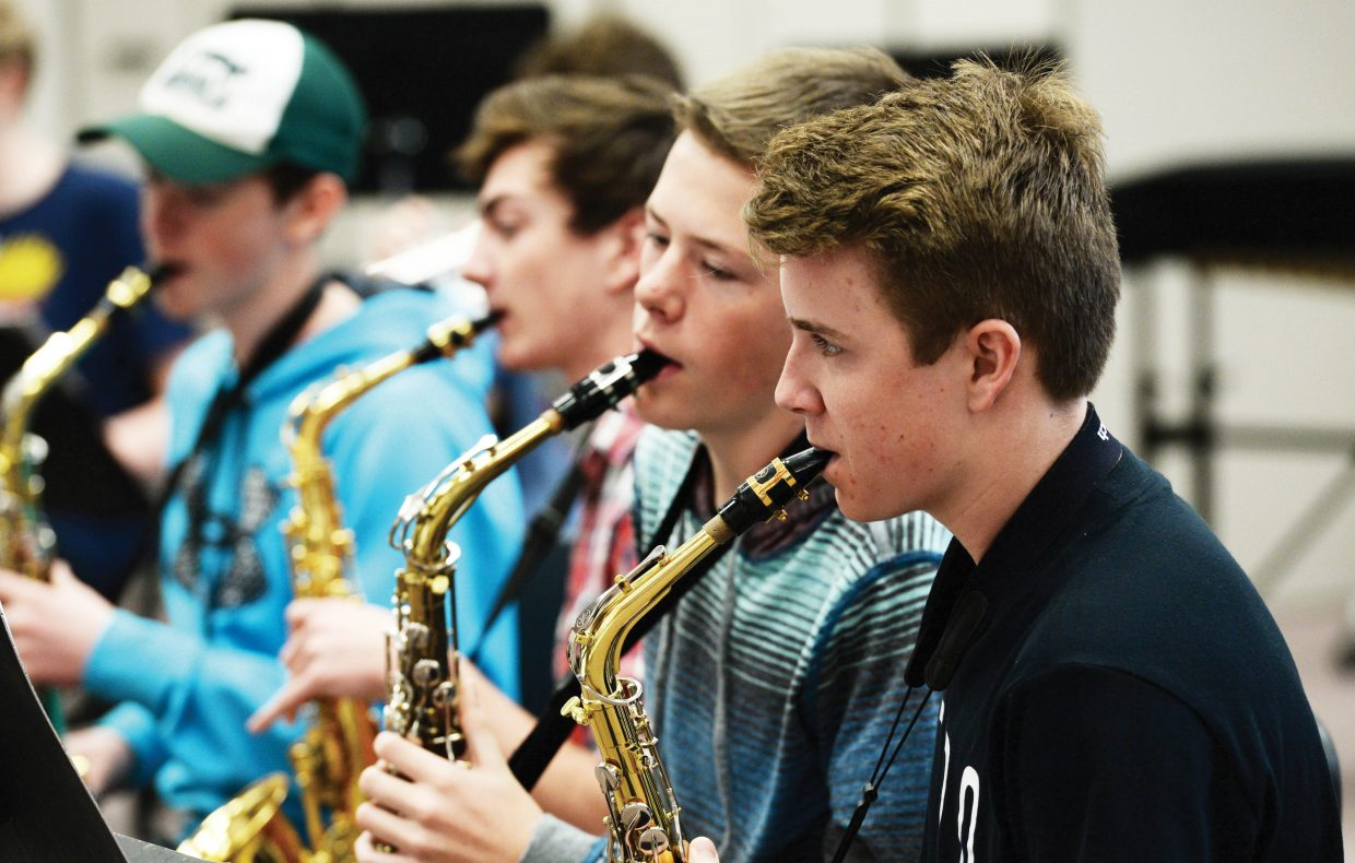 Freshman saxophone player Julian Bowman plays with Trout Steak Revival while preparing for an upcoming concert earlier this week. The members of Trout Steak Revival have been working with area music students across Routt County as part of the Strings Music Festival's School Days Program.