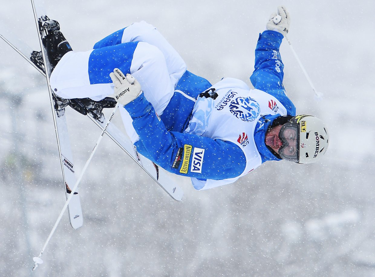 Steamboat Springs skier Jeremy Cota spins through a cork 720 during Thursday's men's moguls qualification round at the U.S. Freestyle Skiing Championships at Steamboat Ski Area. Cota qualified seventh, making the cut. Thomas Rowley was first. The top 16 skiers advanced to Friday's finals.