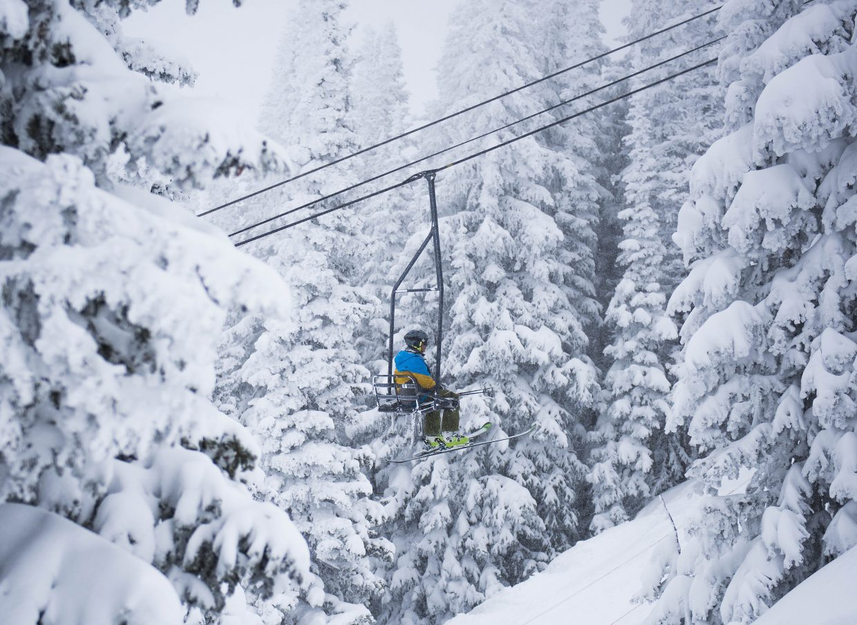 A skier rides up Bar UE chairlift on Thursday at Steamboat Ski Area.