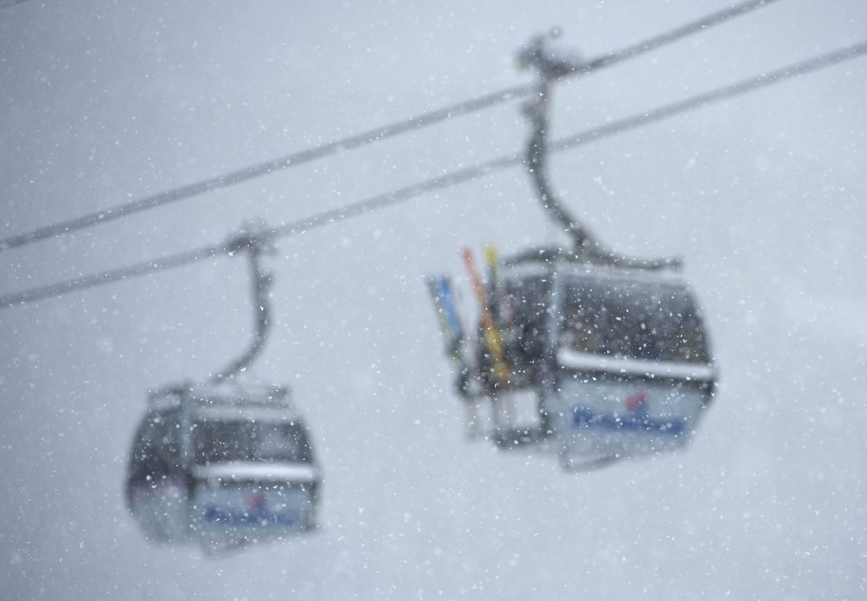 Snow falls in front of gondola cars at the Steamboat Ski Area on Thursday. The day brought a wealth of spring powder for skiers and snowboarders eager for fresh snow.