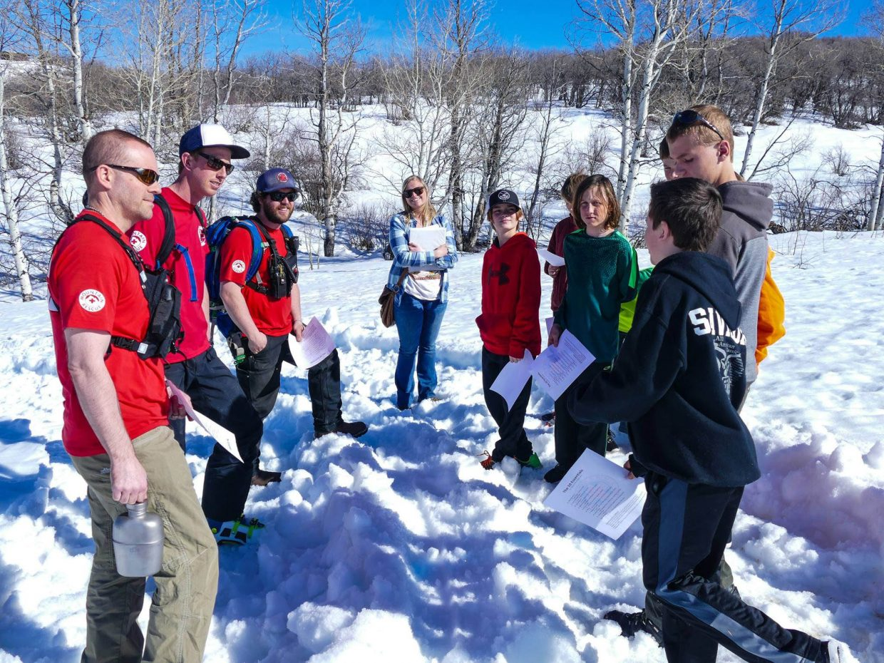 Local youth visit with Routt County Search and Rescue volunteers on Emerald Mountain during a new outdoor education class offered by the city.