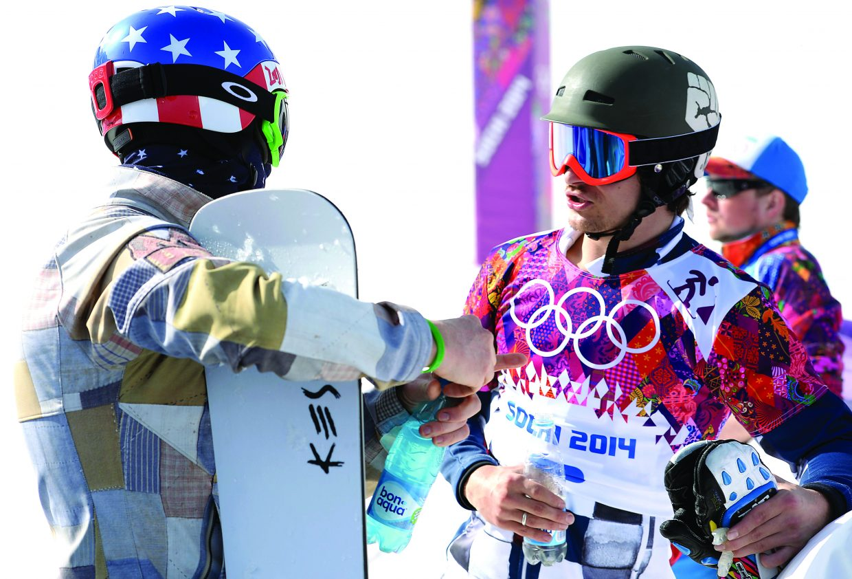 American snowboarder Justin Reiter talks with former teammate, and Russian snowboarder Vic Wild at the 2014 Winter Olympic Games in Sochi, Russia. Both Reiter, and Wild placed near the top of the points list for this year's World Cup standings.